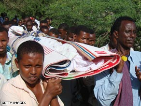 Colleagues carry the body of Somalia's Shabelle radio network's director, Mukhtar Mohammad Hirabe, on Sunday.