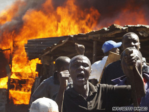 Residents of a Nairobi slum shout during clashes between two rival groups in January 2008.