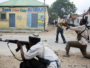 Islamist fighters exchange gunfire with government forces in Mogadishu on July 3.