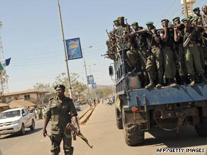 Anti-riot policemen patrol the streets in Jos, Nigeria, following riots between Christians and Muslims.