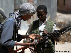 Al-Shabab fighters count their bullets in neighborhood of Mogadishu.