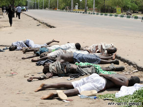 Children who hid in a police office while Islamic radicals took villagers hostage stand in Maiduguri last week.
