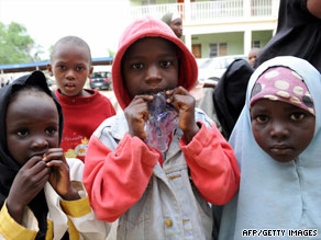 Children who hid in a police office while Islamic radicals took villagers hostage stand in Maiduguri.