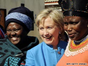 Secretary of State Hillary Clinton poses with residents of South Africa on Saturday during her 11-day trip to Africa.