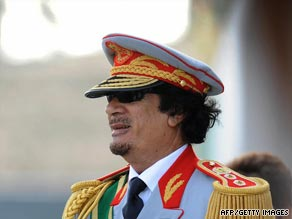 Libyan leader Moammar Gadhafi greets guests at a military parade in Tripoli earlier this month.