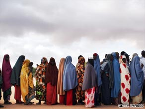 Somali refugees in Kenya queue to find out about a move to a displacement camp.