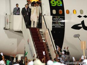 Abdelbaset Ali Mohmed al Megrahi (second from left) arrives in Tripoli, Libya, on August 21.