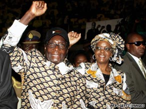 Zimbabwean President Robert Mugabe and his wife Grace arrive for a ZANU PF party youth conference on September 11, 2009