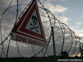 "Signs such as this were still up in ""toxic zones"" around Abidjan, Ivory Coast, a year after the waste dumping."
