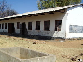 In the classroom, facilities are at a minimum and some children sit on the floor for lessons.