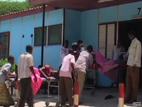 Casualties are taken into Mogadishu's hospital on stretchers.