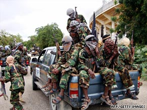 Al-Shabaab militants ride through Mogadishu, Somalia, after a religious gathering in September.