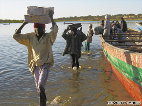 Porters remove goods from a boat on Lake Chad in 2007.
