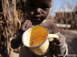 A Turkana boy holds an empty cup in a village in northwestern Kenya.