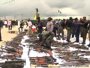 Hundreds of militants have laid down their weapons in exchange for a pardon and a job.