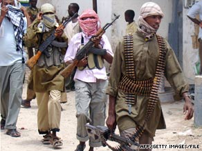Members of Islamist militia Al-Shaabab patrol Bakara Market in Mogadishu, Somalia, earlier this month.