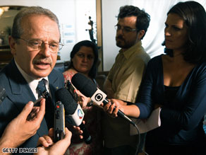 Brazil's Minister of Justice Tarso Genro talks with reporters on Wednesday.