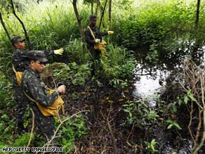 Brazilian soldiers pour insecticide to fight dengue fever in 2008. Bolivia also is battling the mosquito-borne disease.