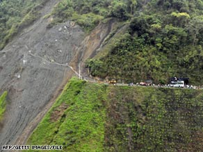 Colombians make their way across a landslide in November after the Nevado del Huila volcano erupted.