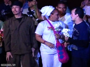 Some of the freed hostages gather for cameras shortly after landing at the Villavicencio Airport Sunday evening.