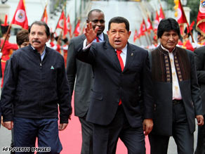Venezuela's Hugo Chavez, center, is flanked by Bolivia's Evo Morales, right, and Nicaragua's Daniel Ortega.