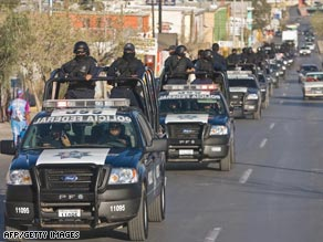 Mexican federal police operate a vehicle checkpoint in Ciudad Juarez on Monday.