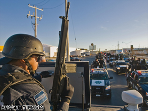 A federal police officer guards a checkpoint earlier this month in Ciudad Juarez, Mexico.