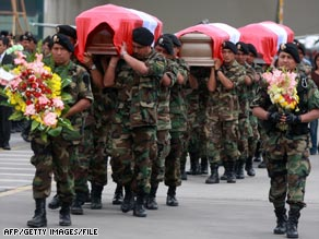 Police in Lima, Peru, carry coffins of officers killed in a November ambush by suspected Shining Path rebels.