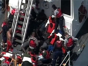 The Coast Guard said it rescued 26 people from a capsized boat off the coast of Florida.