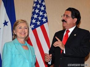 Honduran President Jose Manuel Zelaya Rosales says farewell to Hillary Clinton at Wednesday's OAS meeting.