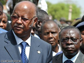 Guinea-Bissau Prime Minister Carlos Gomes Jr, left, and interim President Raimundo Pereira are currently out of the country.