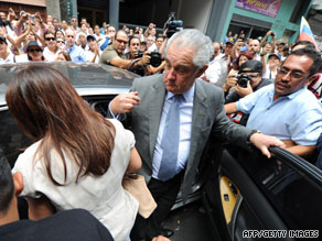 Globovision chief Guillermo Zuloaga gets in a car after a hearing Thursday in Cararas, Venezuela.