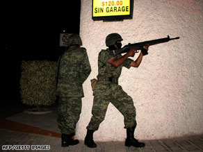 Mexican soldiers hold rifles Saturday during a clash with organized-crime suspects in Acapulco.