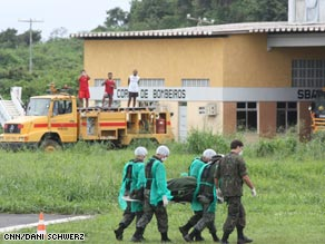 A forensic medical team carries the first of the bodies to be recovered from the Air France flight.