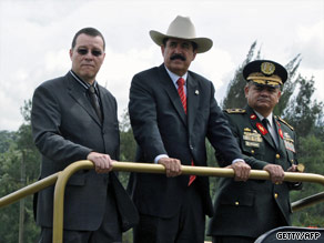 President Manuel Zelaya Rosales, middle, reviews troops with Gen. Romeo Vasquez Velasquez, right, in 2008.