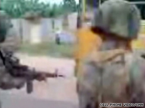 This image from a cell phone video shows Honduran soldiers shooting out the tires of a bus.