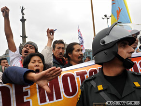 Public transportation service workers protest in Lima, Peru, on Wednesday during a strike against the government.