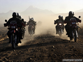 Police on motorcycles escort Luis Arce Gomez to jail in Boliva on Thursday after his deportation from the U.S.