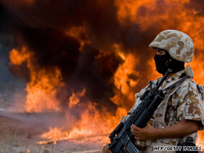 Mexican marine stands guard as 7,000 kilograms of marijuana are incinerated in Mexico's Sonora state.