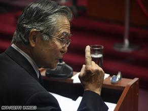 Former Peruvian President Alberto Fujimori speaks in court in Lima, Peru, in April.