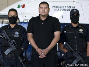 Police present suspected drug dealer Jose Alberto Lopez Barron to the media Wednesday in Mexico City.