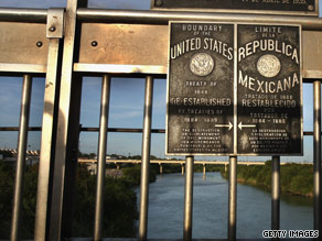 Plaques mark the U.S.-Mexico border near Laredo, Texas.