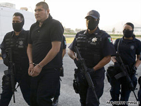 Police escort suspected drug cartel leader Jose Alberto Lopez Barron on Wednesday in Mexico City.