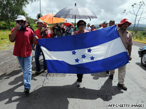 Supporters of Manuel Zelaya march Sunday in support of the ousted Honduras president.