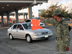 A Mexican soldier controls traffic at the Mexico-U.S. border customs post in Ciudad Juarez on August 16.