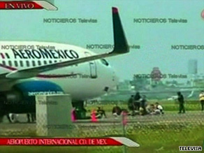 Military personnel surround a hijacked Aeromexico jet after it landed Wednesday in Mexico City.