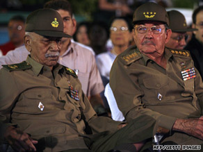 Almeida, left, sits with President Raul Castro on January 1, the 50th anniversary of the Cuban Revolution.