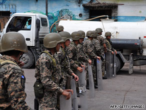 Ousted Honduran President Jose Manuel Zelaya, right, faces reporters Friday at the Brazilian Embassy.