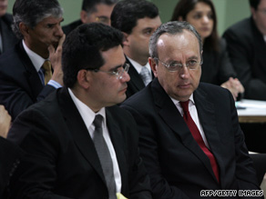 Former Costa Rican President Rafael Calderon, right, listens to his sentence on Monday in a San Jose court.