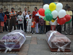 Empty coffins sit in Bolivar Square in Bogota, Colombia, last month during a protest against the killings.